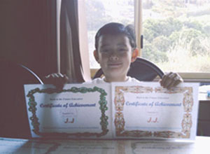 JJ with his MathsPower Certificates.